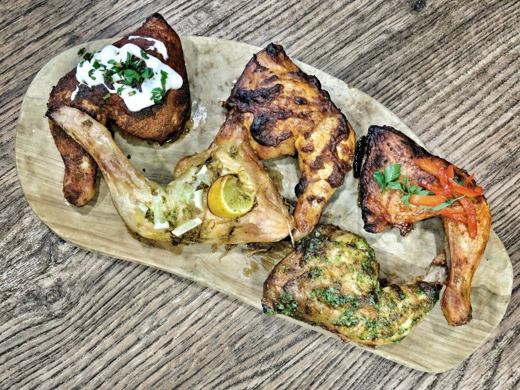 Image of Roasted Harissa, Lemon & Herb, BBQ, Pesto and Thai Chicken Legs