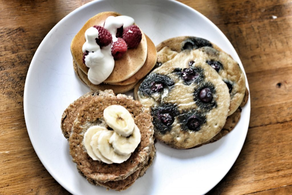 A selection of Oat & Banana, Blueberry & Coconut and My Protein Maple Syrup with Raspberries and Greek Yoghurt Pancakes