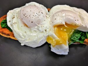 A Breakfast idea. Sweet Potato Toast with Wilted Spinach and Poached Eggs.