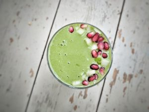 Breakfast ideas. A glass of Matcha, Oat and Apple Smoothie.