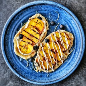 Grilled flatbreads with grilled peaches and honey
